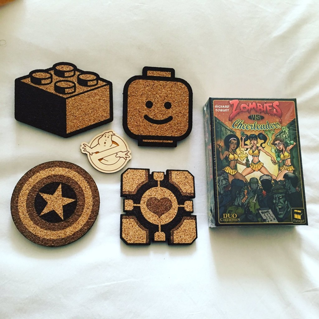 Coasters and a magnet from Dapper Devil, and a zombie card game from Asmodee! Photo by Arnold T. Blumberg
