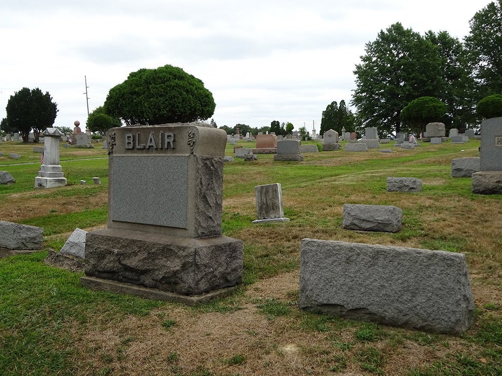 To give you some context, the chapel is behind us and back to the right along a narrow road to the cemetery entrance, but here you can see the Kramer gravestone on the left in relation to the Blair/Cole graves. Photo by Natalie B. Litofsky