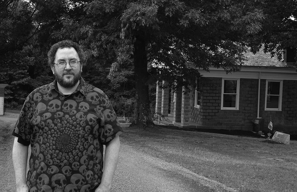 While I didn't want to disrespect any graves by posing with individual markers, I maintained a reasonably solemn smile and posed for a picture with the chapel. Then I just had to turn it black and white. Photo by Natalie B. Litofsky