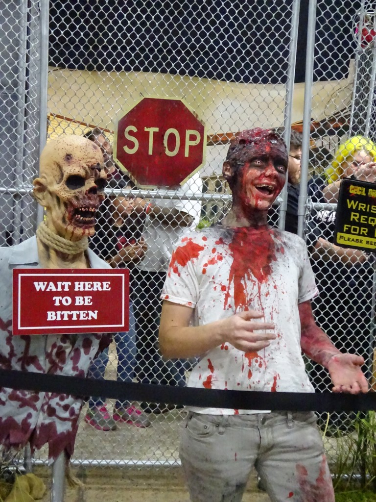 This laughing zombie was soliciting attendees to come into the fencing for a photo op, but he creeped the hell out of me.  Photo by Natalie B. Litofsky