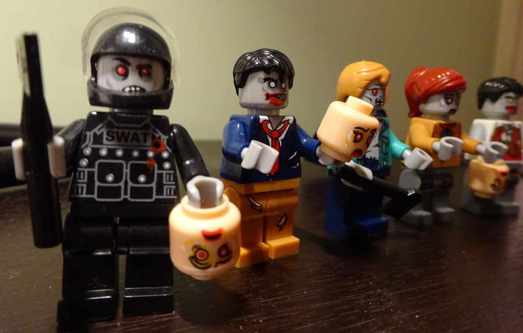 The zombie minifigs are formidable - they've beheaded other LEGO minifigs and carry the trophies! Photo by Natalie B. Litofsky